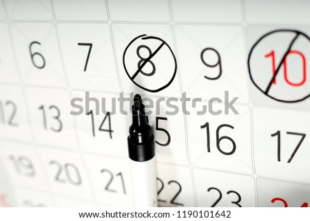 Picture of marker on the white calendar page.