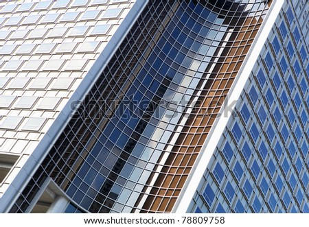 picture of modern multistory building made of glass and concrete