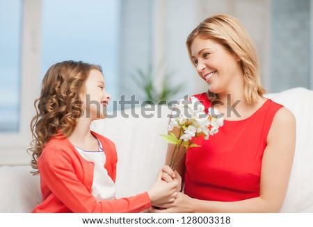 picture of mother and daughter with flowers