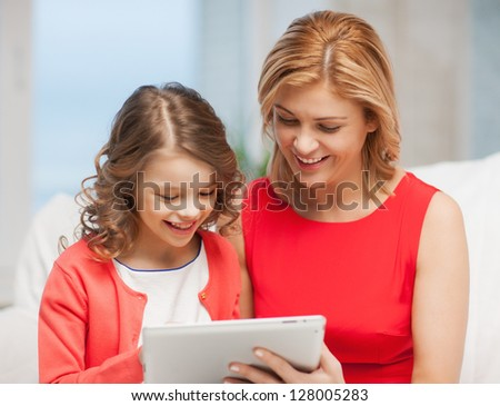 picture of mother and daughter with tablet pc