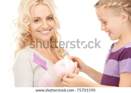picture of mother and little girl with piggy bank (focus on woman)