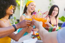 Picture of multiracial group of friends toasting with cocktails - concept of friendship, celebration and vacation