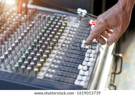 Picture of Musical amplifier Sound amplifier or Music mixer with Knobs, Jack holes and Mic connectors . The part of Musical amplifier Sound amplifier or Music mixer with Knobs and Jack holes