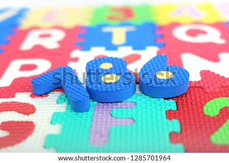 Picture of numbers on the colored alphabets letters.