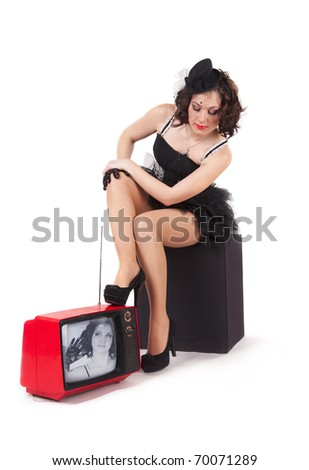 Picture of old-fashioned girl watching old tv