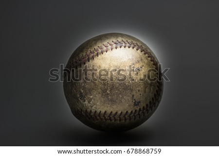 picture of old softball on black background