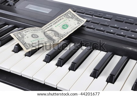 Photo of Picture of one dollar of lying on an old worker synthesizer musician