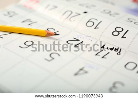 Picture of pencil on the calendar.