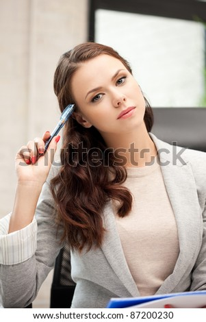 picture of pensive woman with big notepad