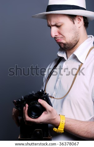 Picture of photographer  who trying to use the old camera