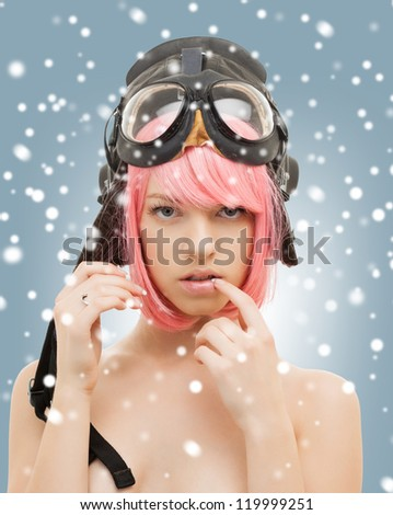 Stock Photo picture of pink hair girl in aviator helmet with snow