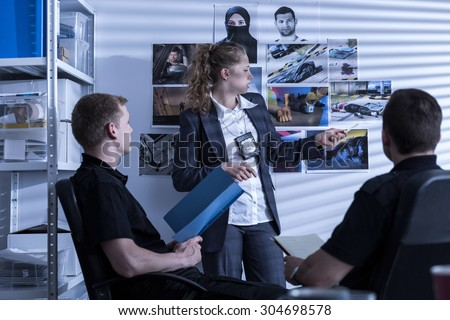 Picture of police team during investigation watching evidences