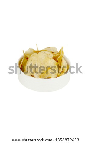 Picture of potato chips in the white bowl for navratri festival. Isolated on the white background.