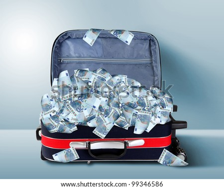 Picture of red travel suitcase full of banknotes