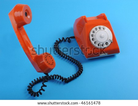 Picture of retro telephone over blue background