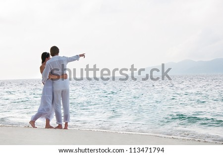 Picture of romantic young couple on the sea shore
