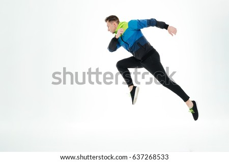 Picture of serious strong sportsman running isolated over white background. Looking aside. #637268533