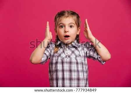 Picture of shocked little girl child standing isolated over pink background. Looking camera. #777934849