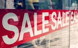 Picture of shop window display with text Sale on red poster