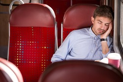 Picture of sleeping male passenger using public transport