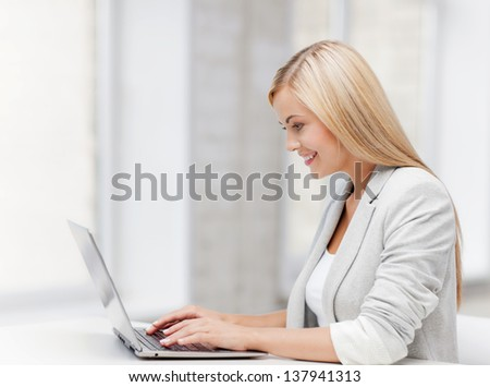 picture of smiling businesswoman using her laptop computer