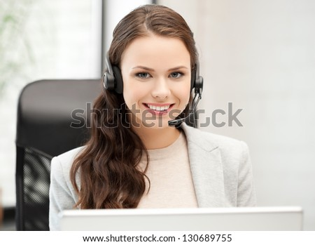 picture of smiling female helpline operator with headphones