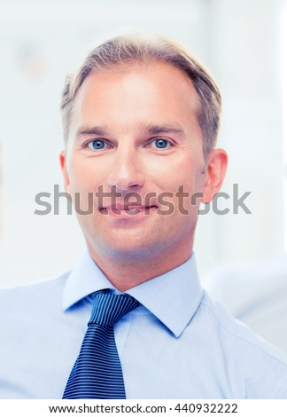 picture of smiling handsome businessman in office
