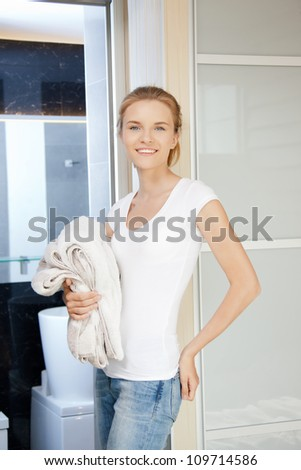 picture of smiling teenage girl with towels