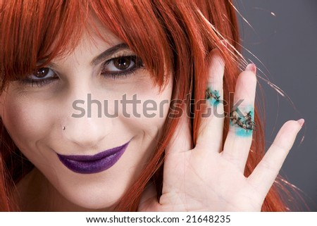 picture of smiling woman showing stitches on fingers