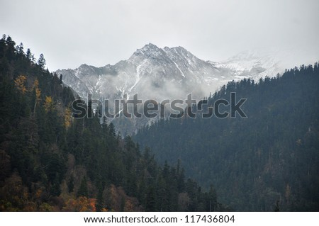 Picture of Snow Mountain covered by Mist.