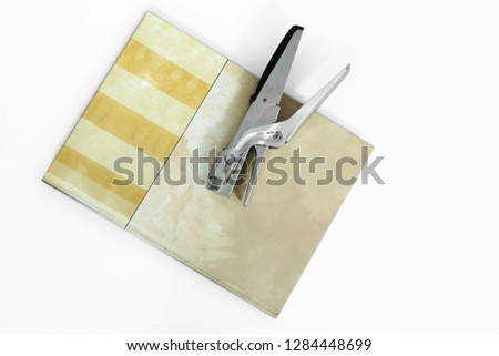 Picture of stapler on the diary. Isolated on the white background.