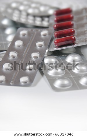 picture of still life of several medication blister with white bottom