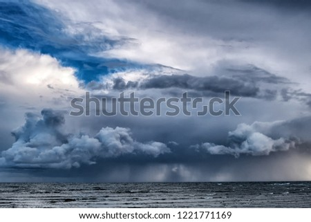 Picture of storm with dramatic clouds at the sea.