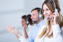 Picture of support phone operators in headset