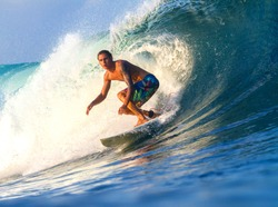 Picture of Surfing a Wave.Sumbawa Island. Indonesia.