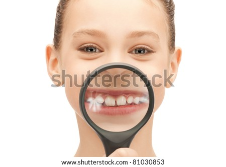 picture of teenage girl with magnifying glass showing teeth