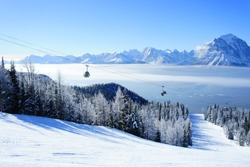 Picture of temperature inversion at Lake Louise, causing a cloud of sea with gondola visible.