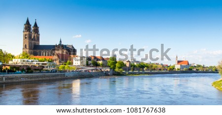 Picture of the City Viewfrom the River Elbe of Magdeburg with the Magdeburg Cathedral as Landmark and the Johannischurch in the further back, taken in Sping