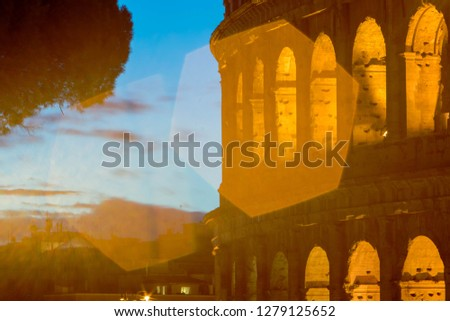 picture of the colosseum taken at sunrise. Nice colors and peculiar shadows in this pic.