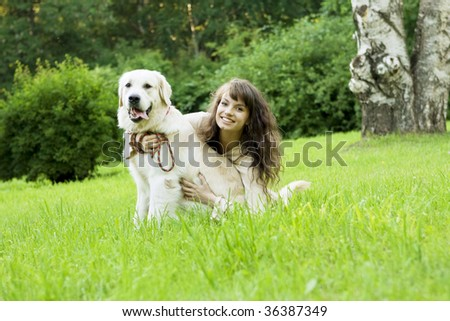 Picture of the girl with the golden retriever walk in the park