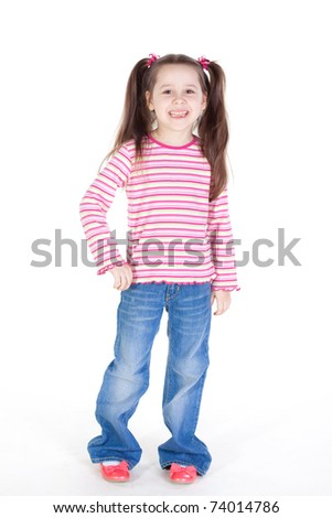 Picture of the happy little girl in blue jeans - stock photo