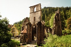Picture of the monastery ruin Allerheiligen (engl. All Saints'Abbey) near Oppenau in the Black Forest, Germany with its tower and arches in the golden evening sunlight.