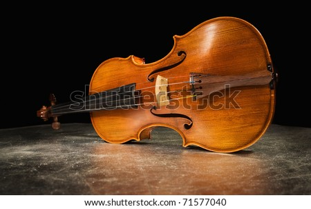 Picture of the old italian violin on a silver background