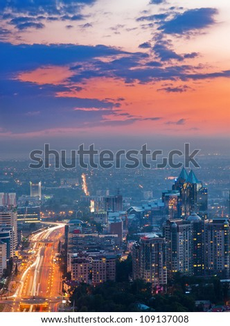 Picture of the sunset lighting of the city of Almaty, made from the top of the mountain.