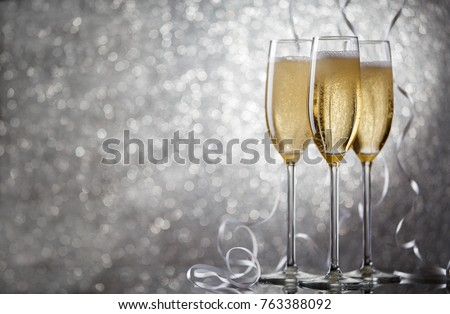 Picture of three glasses with wine on gray background. #763388092