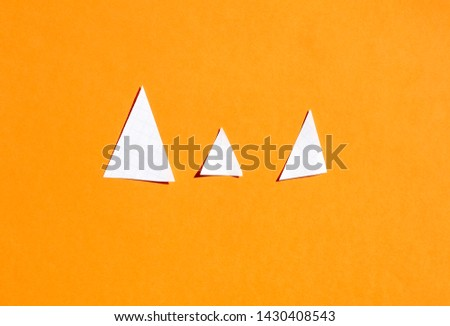Picture of three triangle wich represent happy family (father, mother and child). Concept of full family.