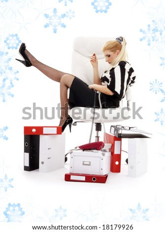 picture of tired businesswoman in chair with snowflakes