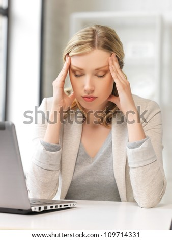 picture of tired woman with laptop computer - stock photo
