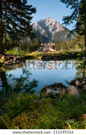 Picture of town of Banff overshadowed by a Rocky Mountain in the background - Banff National Park, Alberta, Canada
