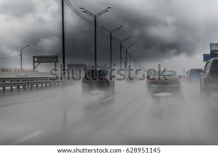 Picture of traffic on the freeway during a storm. Heavy rain on a road.